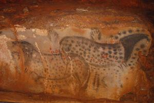 Dotted horses in the cave of Pech-Merle in France