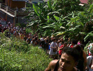 People are evacuated from a shopping centre in Thailand following a tsunami warning