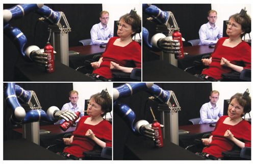 Brain-controlled arm could beat paralysis