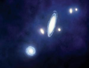 In this section of the Local Group of galaxies, Andromeda is the largest spiral near the centre of the picture and Triangulum is the smaller spiral nearest the bottom. A hydrogen bridge has been confirmed to stretch between them (Artist's impression: Mark Garlick/Science Photo Library)