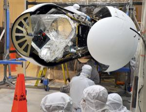 Final checks of NuSTAR in the Orbital Sciences processing facility at Vandenberg Air Force Base, California, before the Pegasus payload fairing is secured around it. NuSTAR is already mated to its Pegasus XL rocket