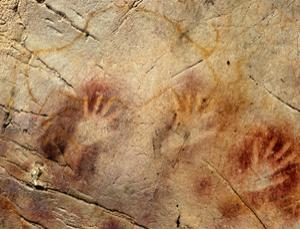 A hand stencil in El Castillo cave, Spain, has been dated to earlier than 37,300 years ago and a red dot to earlier than 40,600 years ago, making them the oldest cave paintings in Europe