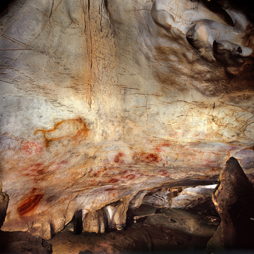 Zoomed-out view of the cave art in El Castillo cave, Spain