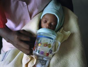 A woman with HIV feeds her baby formula provided by the Botswana government