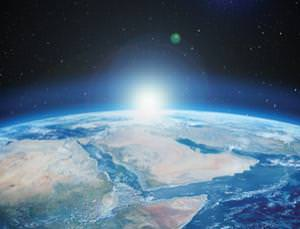 How was Earth's life kindled under a cold sun?