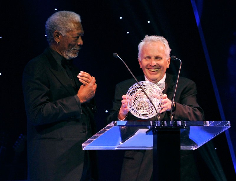 Alexander Polyakov receives his award at a ceremony hosted by Morgan Freeman