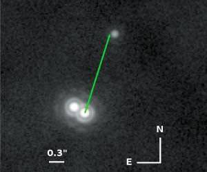 The binary system 2M0103, with its central pair of stars and mystery third object in orbit around them. This infrared image was produced by the Very Large Telescope at ESO-Paranal in Chile
