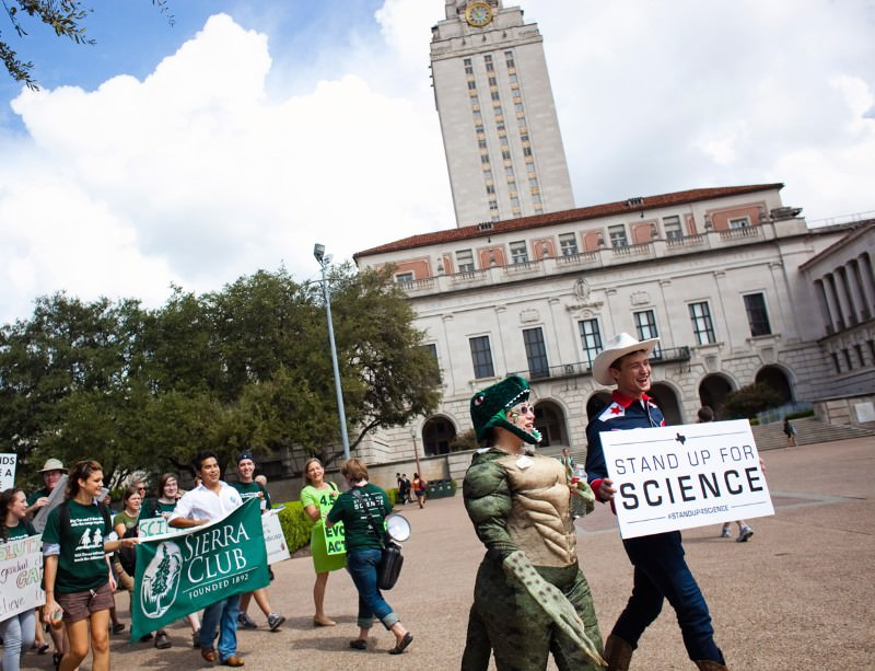 Protesters march to the textbook hearing