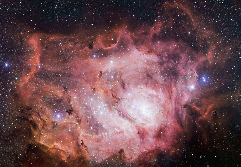 Swim among newborn stars in this vast lagoon of dust