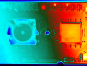 TrueNorth (left of image) runs much cooler than other chips, as this thermal image shows