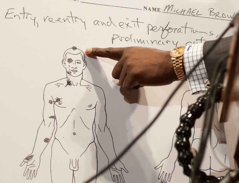 Brown family attorney Daryl Parks points on an autopsy diagram to the head wound that was likely fatal to Michael Brown, during a news conference in Ferguson, Missouri, on 18 August 2014