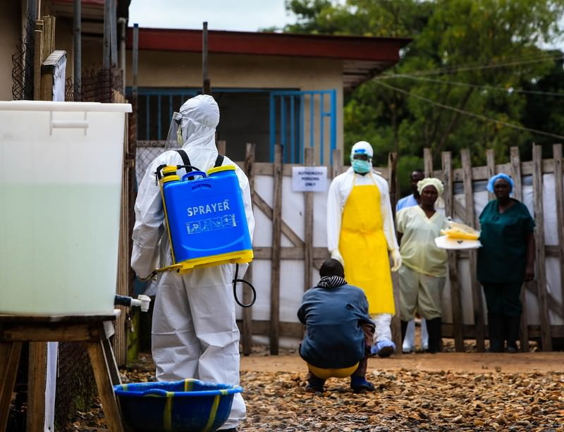 A medical worker outside an Ebola treatment centre at the government hospital in Kenema, in the east of Sierra Leone