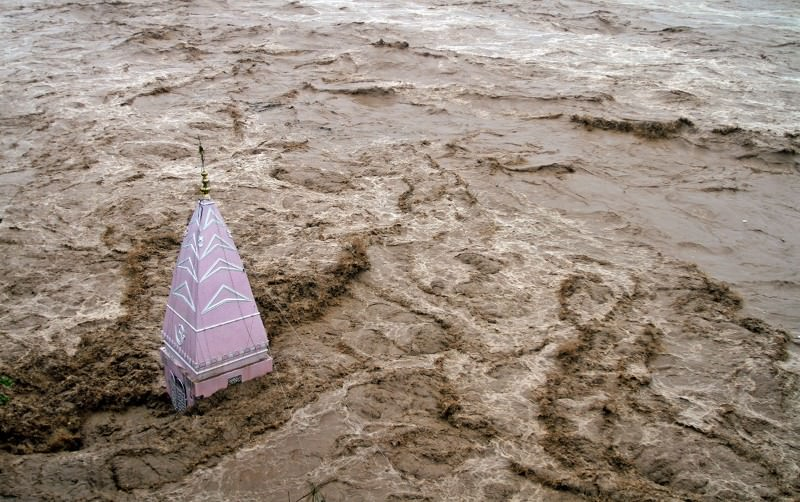 Muddy flood engulfs all but top of Kashmiri temple