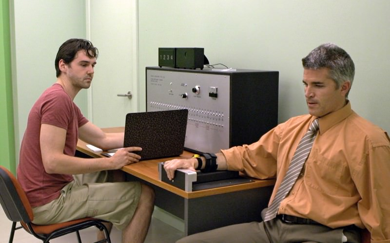 A scene from upcoming film Shock Room, directed by Kathryn Millard, in which Stanley Milgram's experiment was recreated using actors (Graham McRae as Harry and Martin Crewes as The Learner)