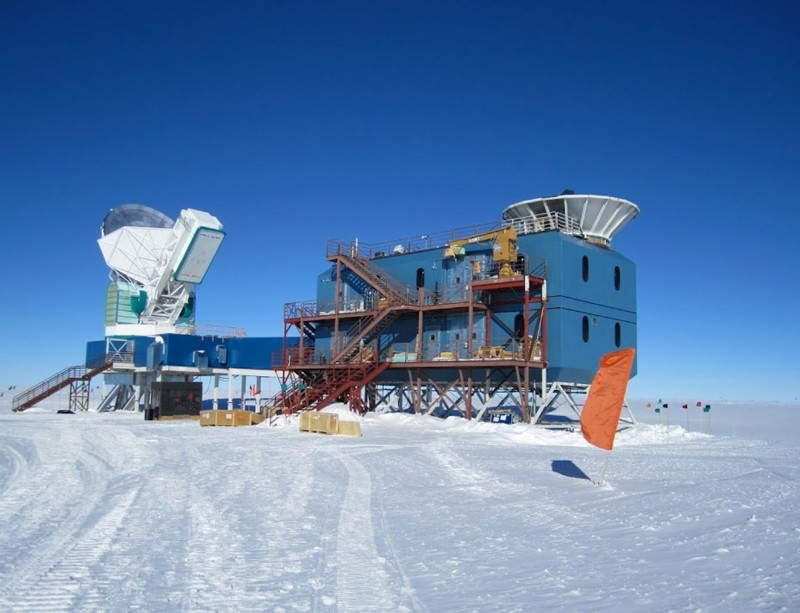 The BICEP2 Telescope is the white dish on the right, with the South Pole Telescope on the left