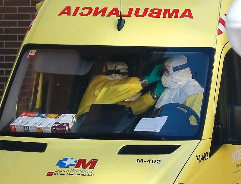 An ambulance at the residence of the nurse in Spain who contracted Ebola