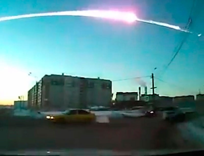 Out of a clear blue sky, a meteor explodes over Chelyabinsk, Russia, last year