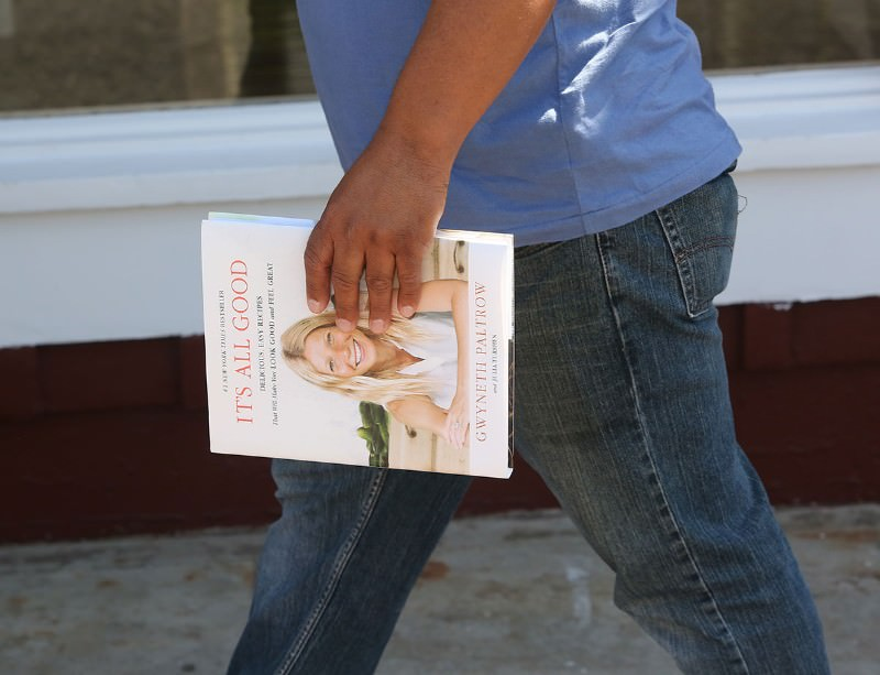 "Person carrying book titled ""It's all Good"" by Gwyneth Paltrow"