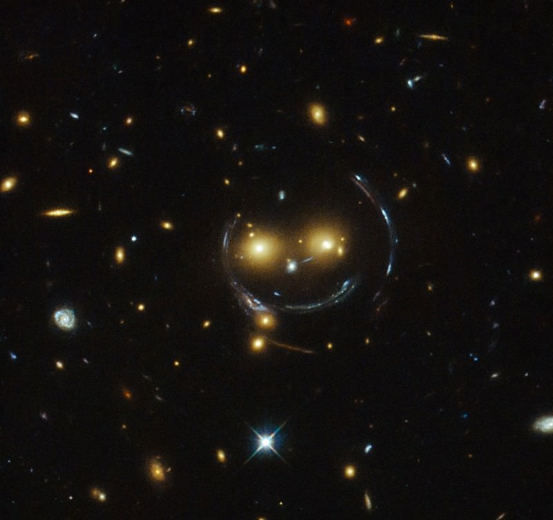 Hovering happy face smiles down on us from space