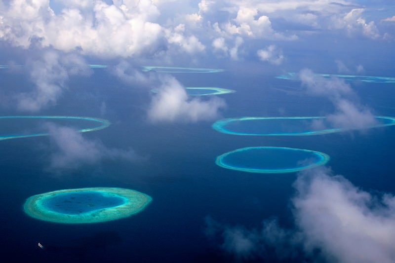 A warmer climate would raise sea levels and swamp islands
