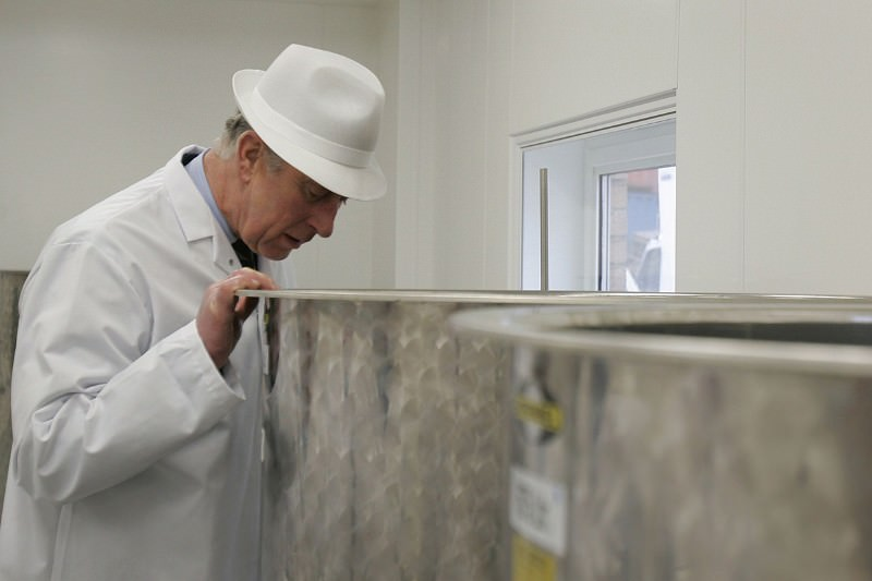 Prince Charles peers into a vat of fermenting herbs on a visit to a factory manufacturing herbal and homeopathic remedies