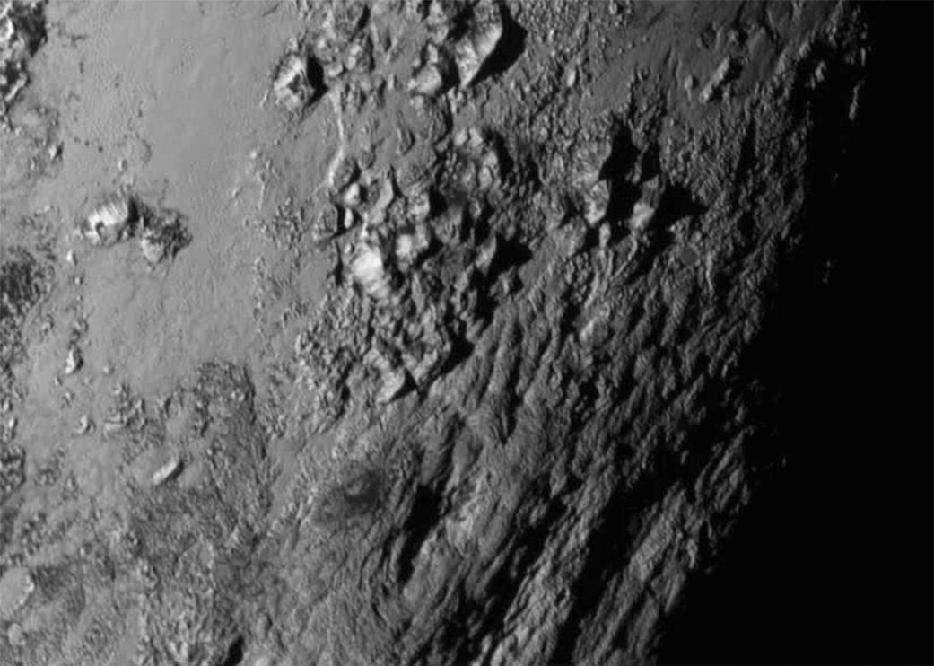 Pluto wows with first close view of ice mountains on its surface