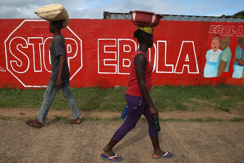 Bolster health systems in poor countries or see another Ebola