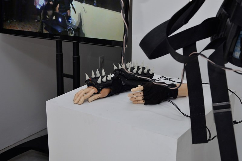 Model hands on a plinth with fingerless gauntlets studded with spikes