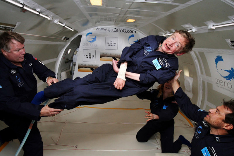 Stephen Hawking floating in zero g inside an aircraft