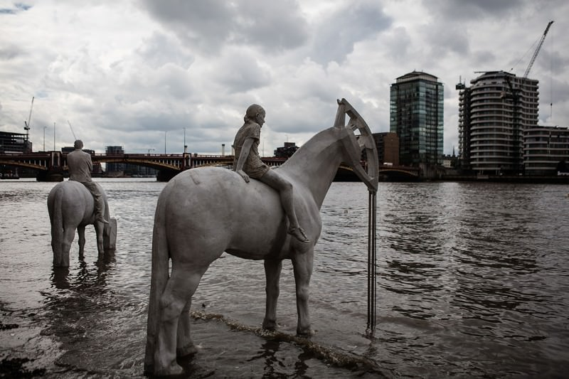 Underwater horse sculptures revealed at low tide in the Thames