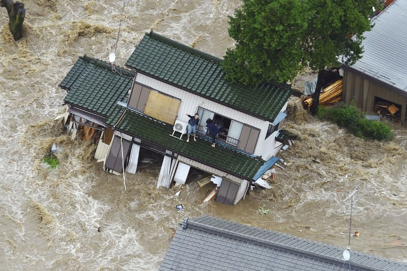 Residents stranded as severe floods wash away homes in Japan