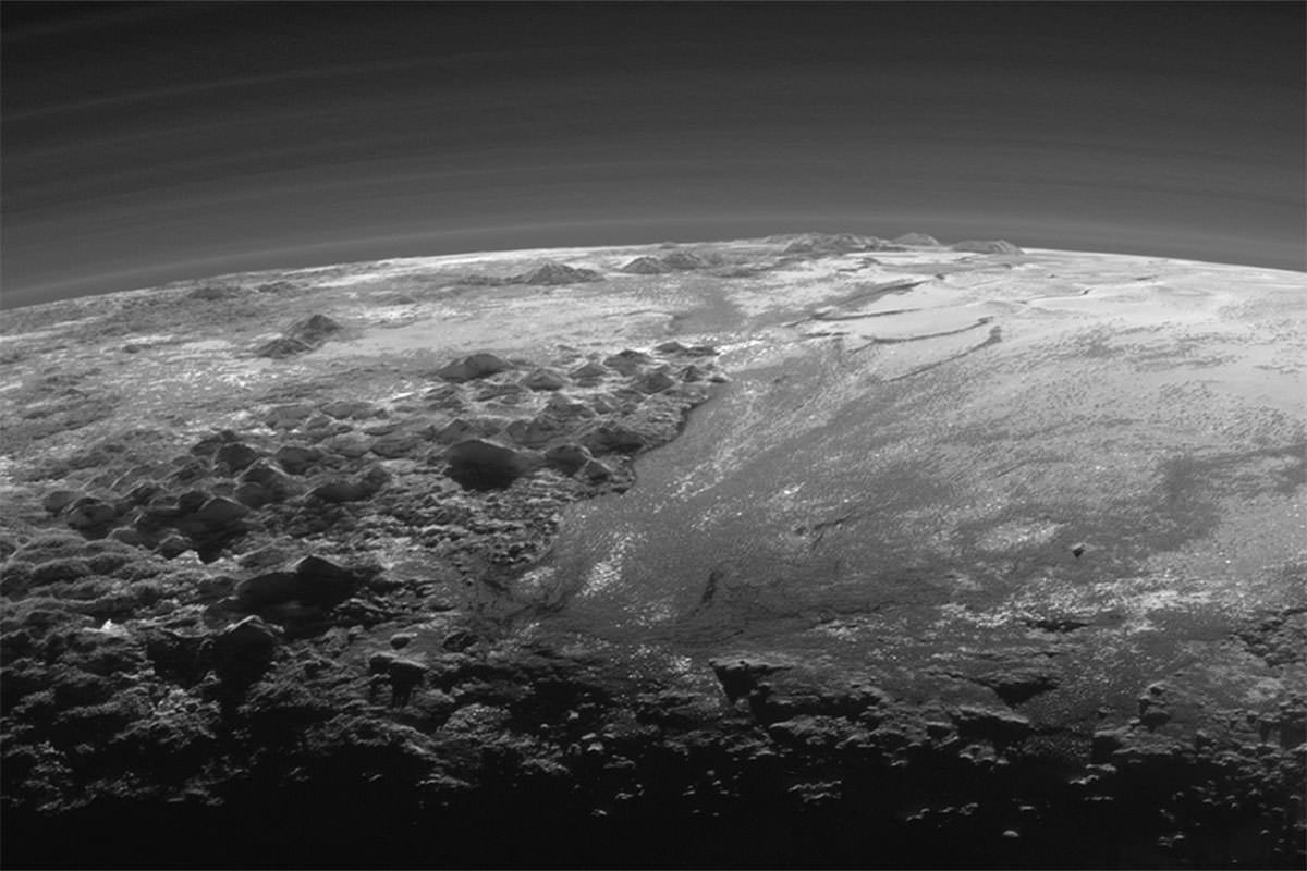 New Pluto pics show weird terrain shaped by alien 'water' cycle