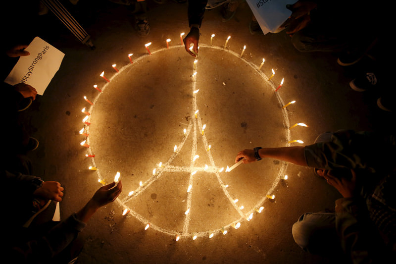 Candles in the shape of a peace symbol at a memorial for the terror attacks in Paris in November 2015