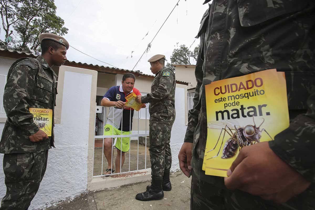 Going door to door to warn about the spread of Zika virus
