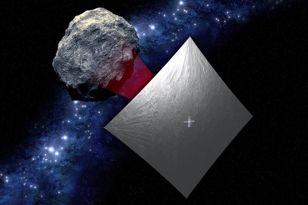 A CubeSat with a solar sail orbits an asteroid