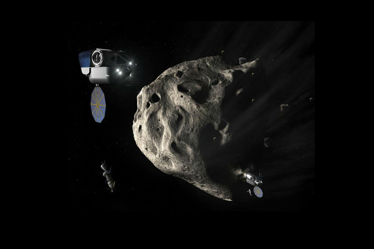 Three satellites surround an asteroid
