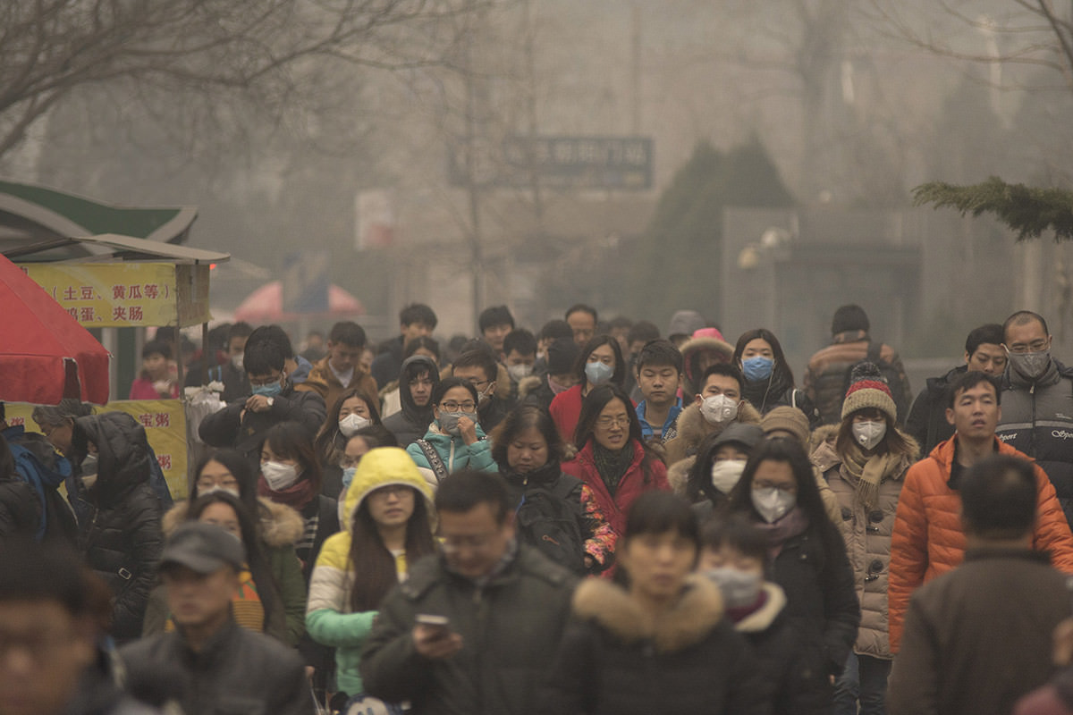 a crowd of people in clearly smoggy dirty air, Beijing