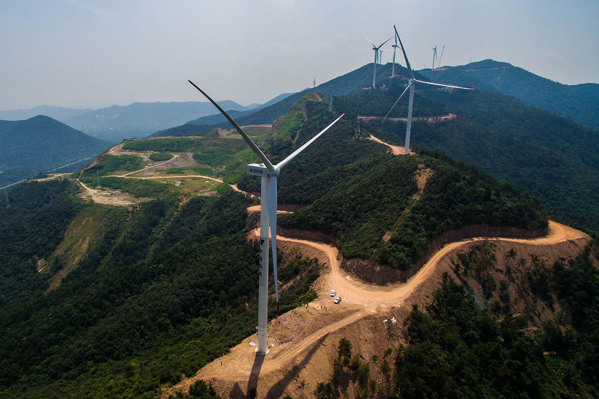 Wind turbines on green hills in China