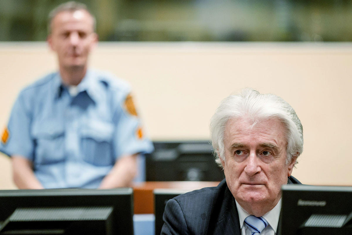 Bosnian Serb wartime leader Radovan Karadzic sits in the courtroom for the reading of his verdict at the International Criminal Tribunal for Former Yugoslavia (ICTY) in The Hague, on 24 March, 2016