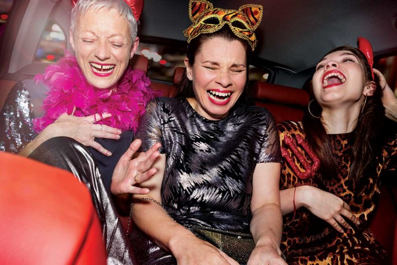 A gorup of women in costumes laughing