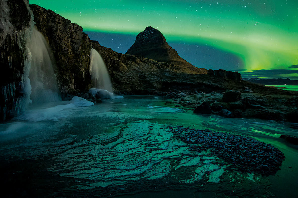 Northern Lights over Icelandic rocky landscape