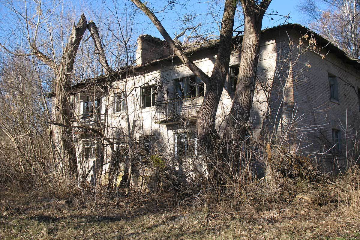 Overgrown house in town of Chernobyl