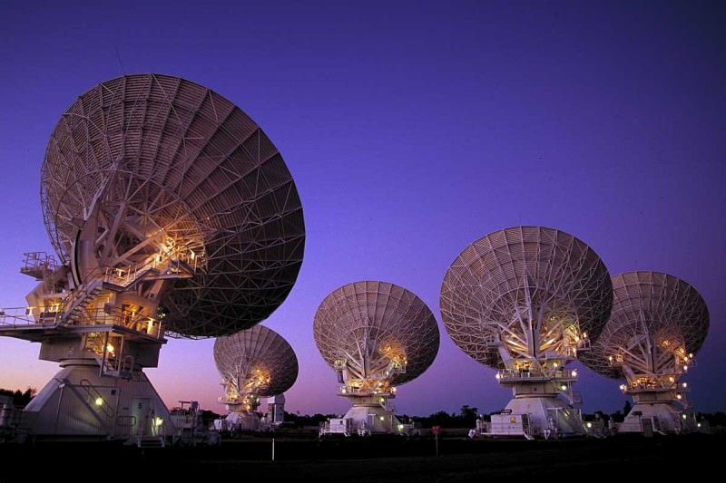 An array of radio telescopes points at the sky