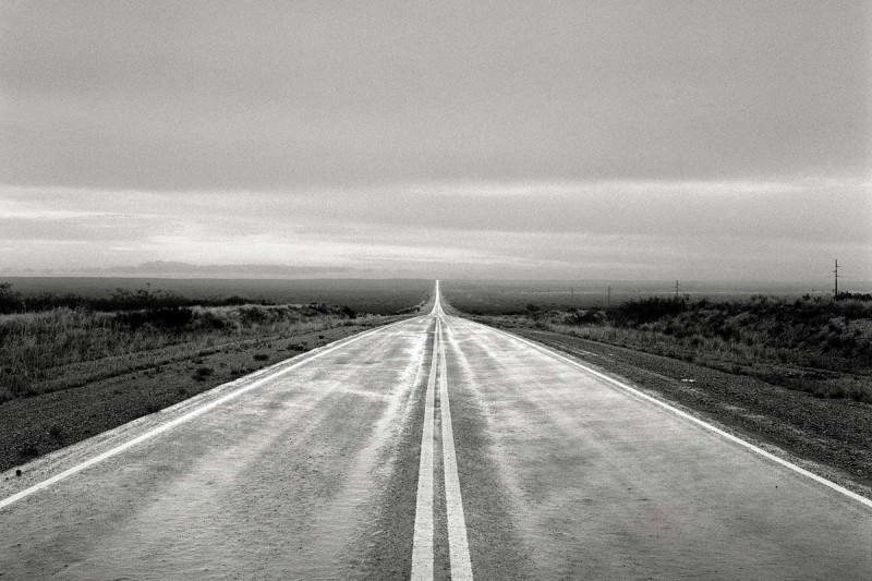 A long straight road carries on into the distance