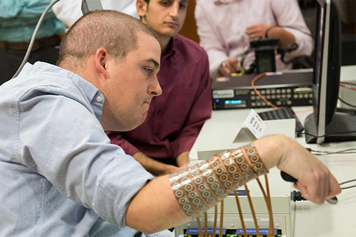 Ian Burkhart moves his hand using a sleeve of electrodes attached to implant in his brain