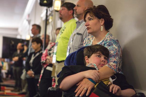 Woman and child in queue in corridor