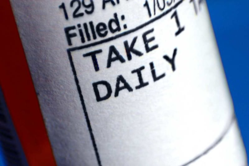 Picture of drug label on bottle, take one daily