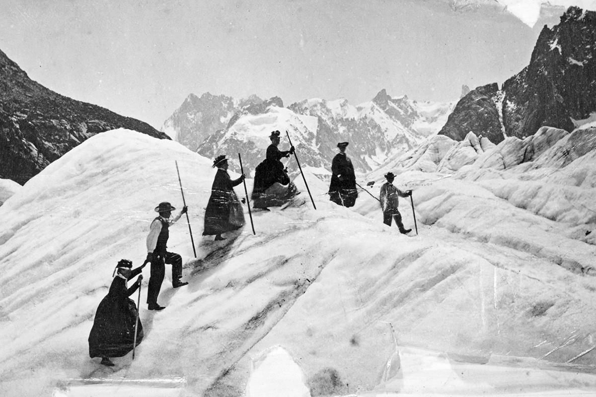 A group of men and women mountain climbing on the Mer de Glace, France, circa 1870