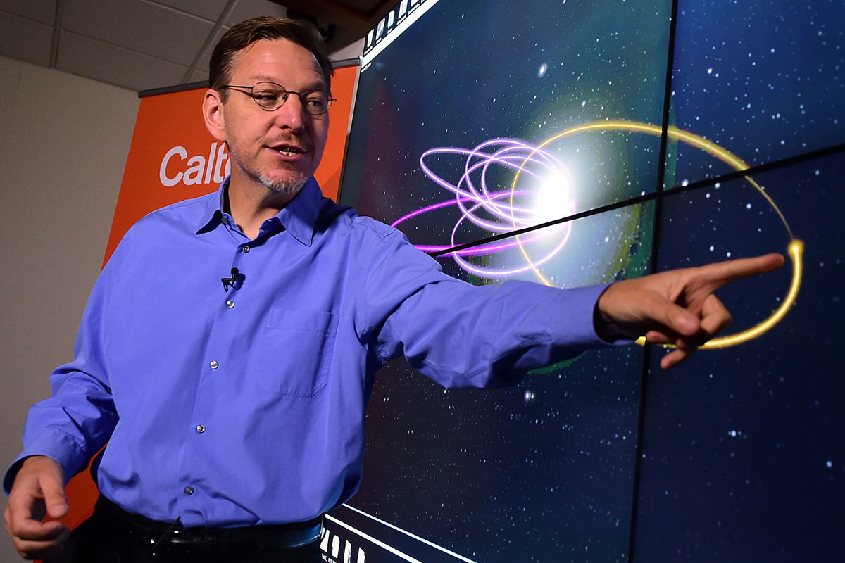 Cal Tech Astronomer Mike Brown points out the 'Predicted Orbit', in yellow, of the 9th Planet at the Caltech Seismology Lab