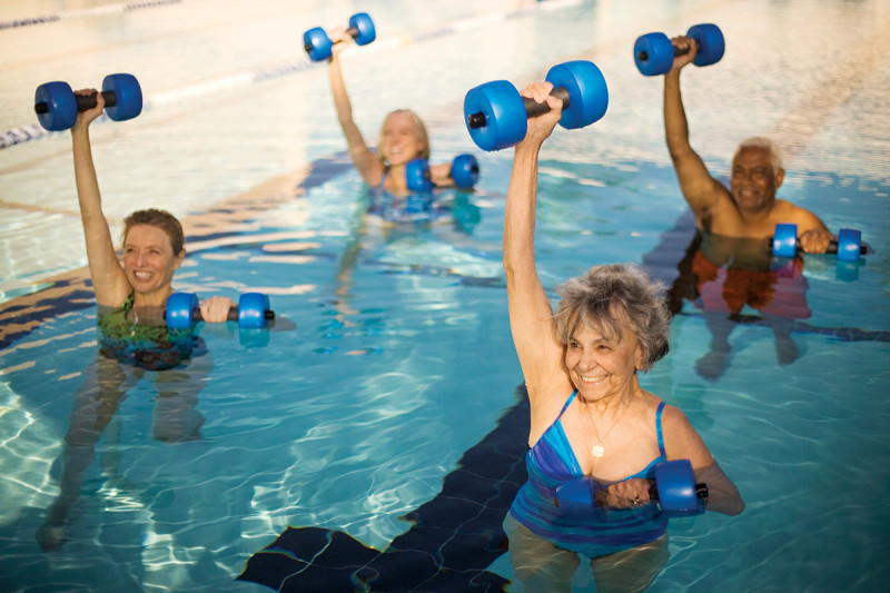 Aqua aerobics class of older people